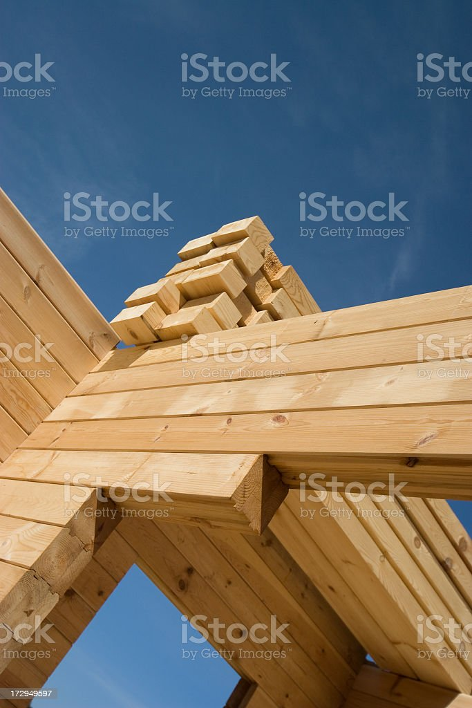 Building of a wooden house- unfinished stock photo