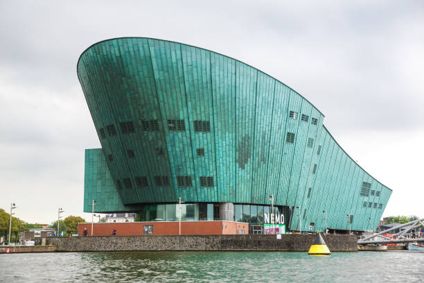 Building of Nemo museum in Amsterdam Amsterdam, Netherlands-August 18, 2015-Building of Nemo museum, view from the water. nemo museum stock pictures, royalty-free photos & images