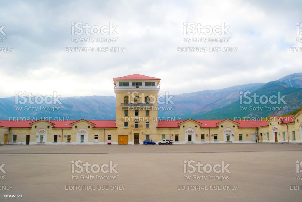 Partenit, Ukraine - October 25, 2012: Building of the plant of Massandra. Massandra — one of the largest entities on cultivation of grapes and production of high-quality vintage grape wines, tobacco, fruit and other agricultural products. stock photo