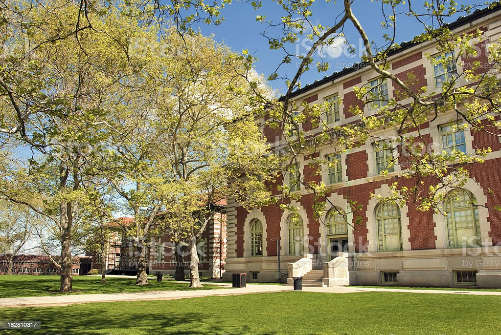 Building on Ellis Island with lawn in New York City stock photo