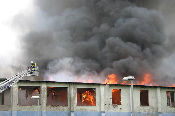 building on fire - disconcert stock pictures, royalty-free photos & images