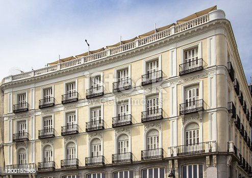 Beautiful buildings in traditional Spanish style on Plaza Ramales in Madrid, Spain