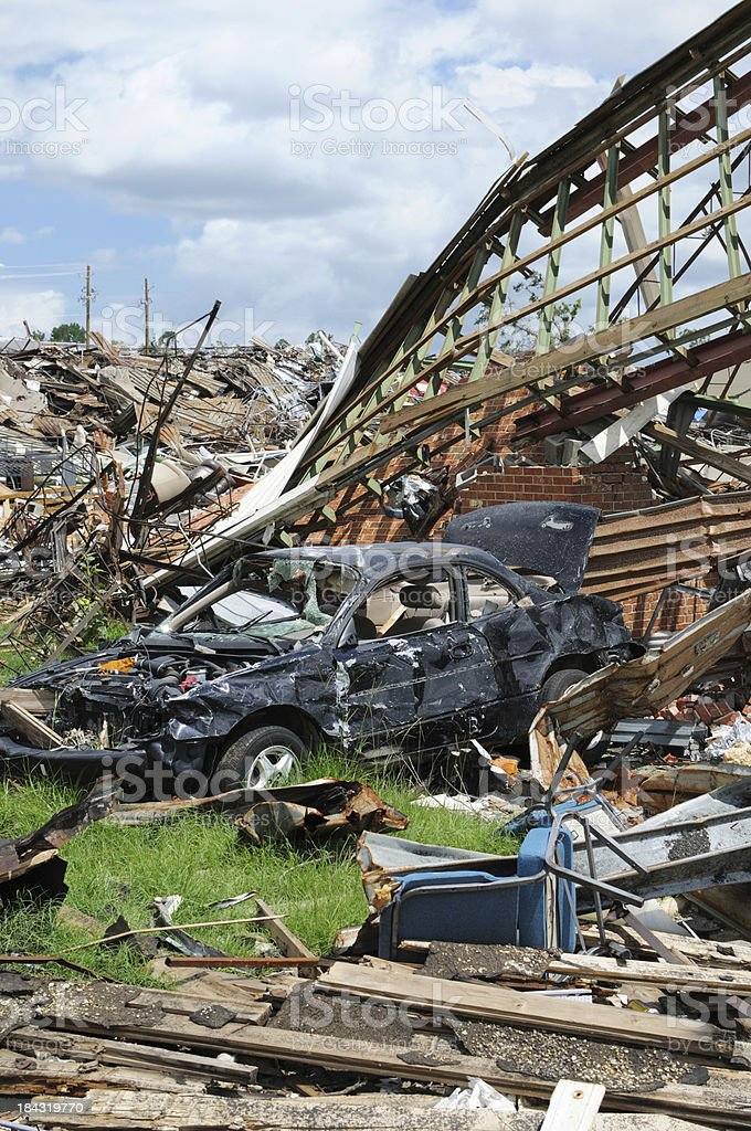 Building on top of car after tornado royalty-free stock photo