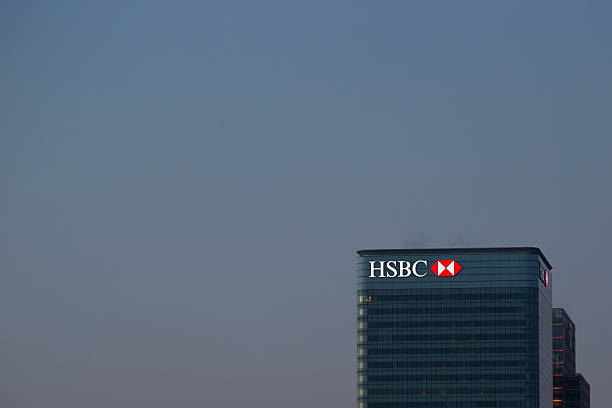 HSBC Building London, United Kingdom - March 21, 2015: The HSBC Bank headquarters in Canary Wharf. The bank has recently been involved in tax evasion scandals. hsbc stock pictures, royalty-free photos & images