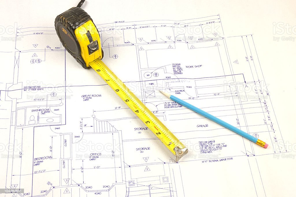 Building plans and tape measure royalty-free stock photo