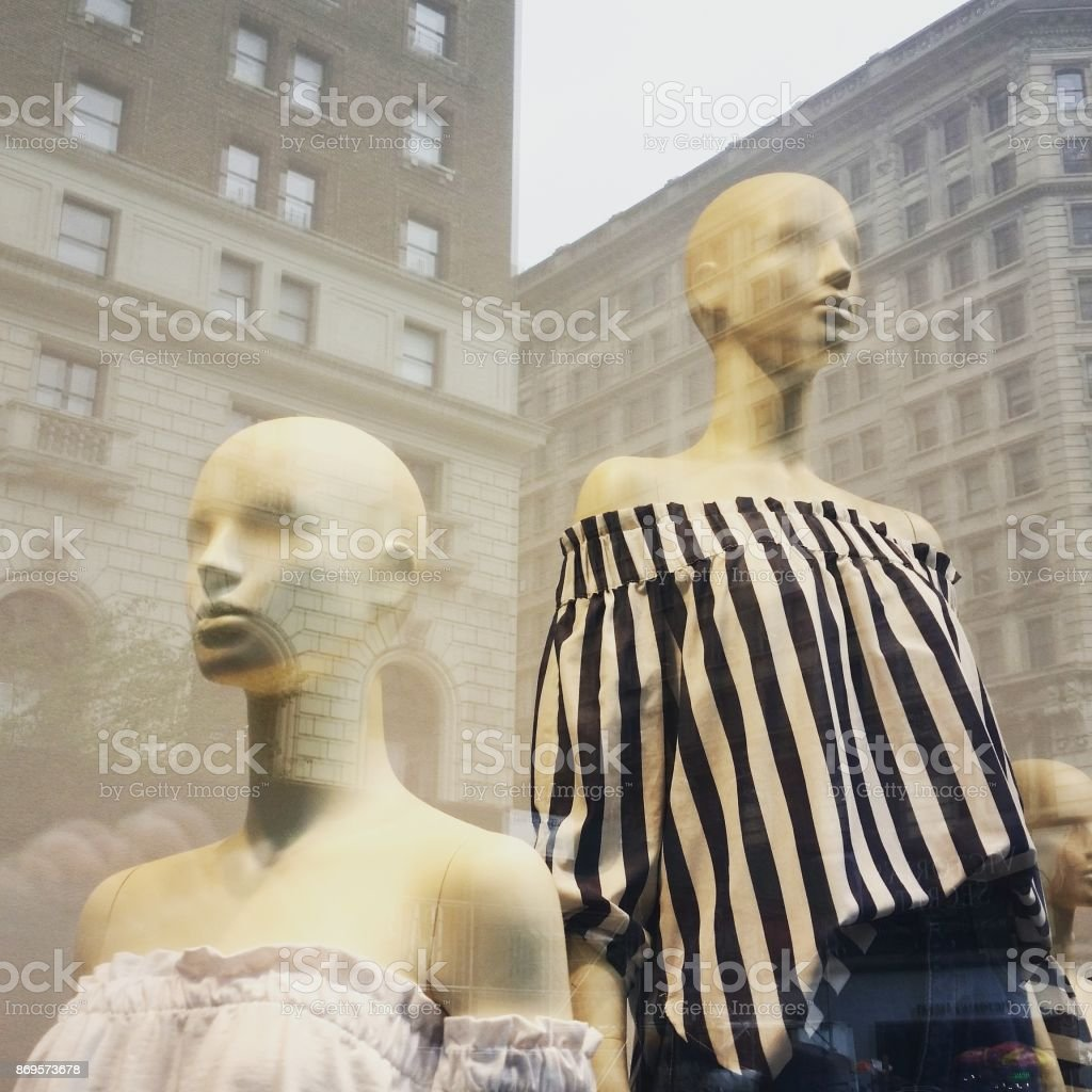 NYC Building Reflections on Retail Store Window with Mannequins