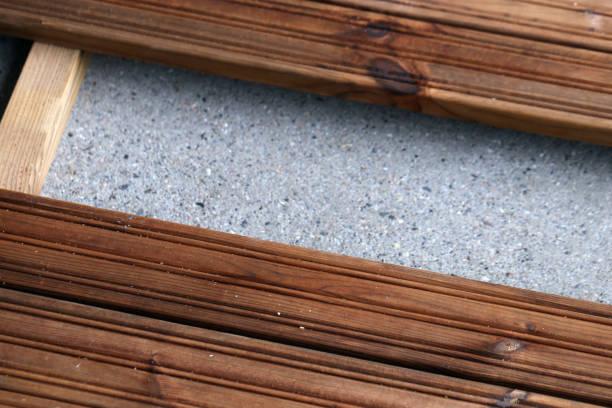 Building / Renovating Balcony with Brown Wooden Floor stock photo