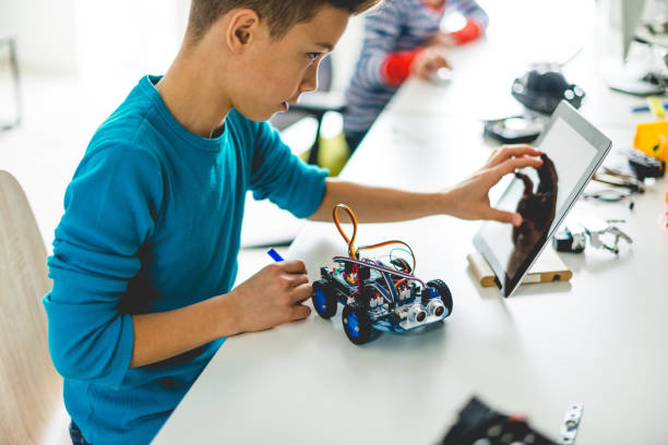 Building robotic car for school assignment stock photo
