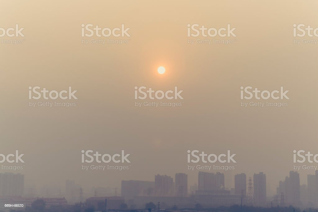 building shot of sunset in beijing on a foggy day stock photo