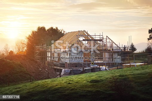 istock Building site with house under construction 637337716