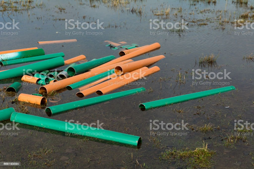 Building site with puddle and water pipes stock photo