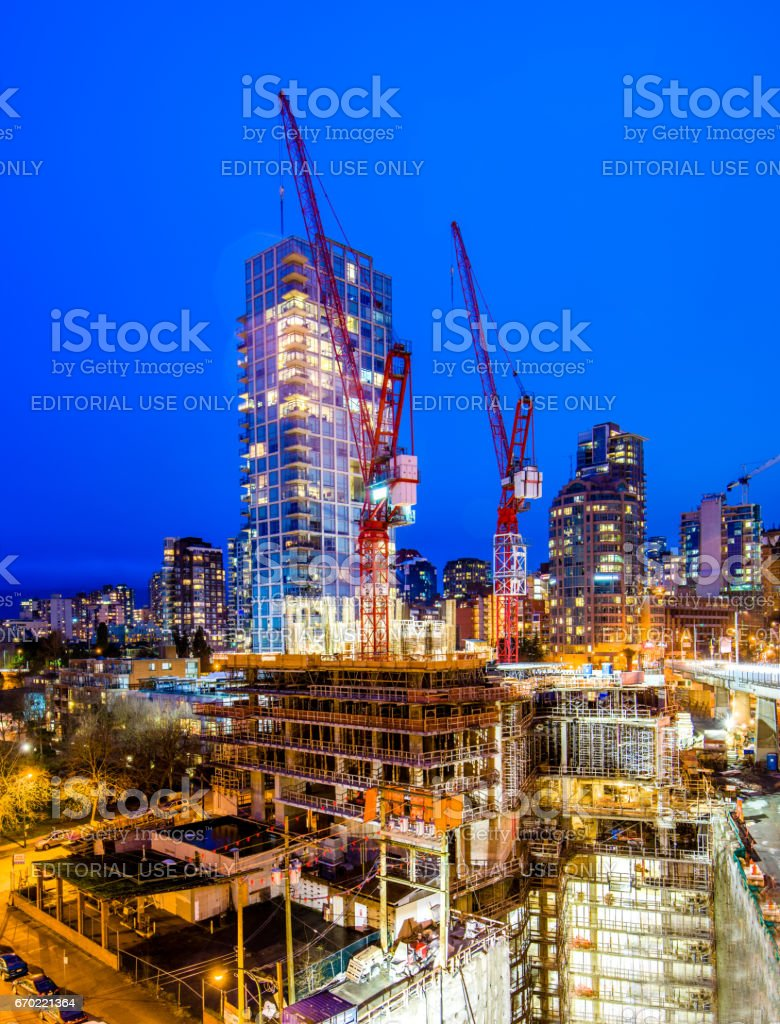 Building skyscrapers at night stock photo