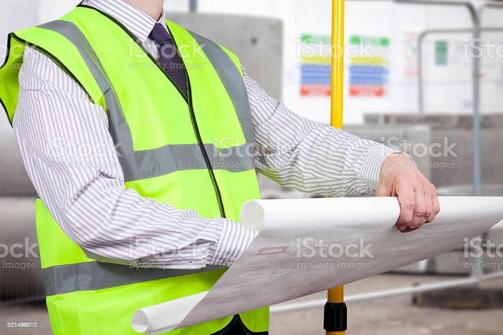 Building surveyor in high visibility inspecting construction pla stock photo