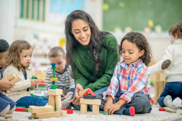 building together - preschool stock photos and pictures