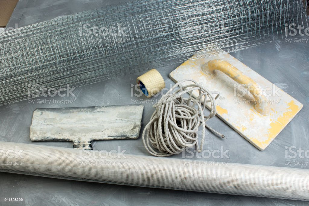 Building tools on the gray concrete background. Copy space. Top view stock photo