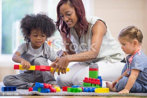639403466istockphoto Building Towers with Plastic Blocks 514561198