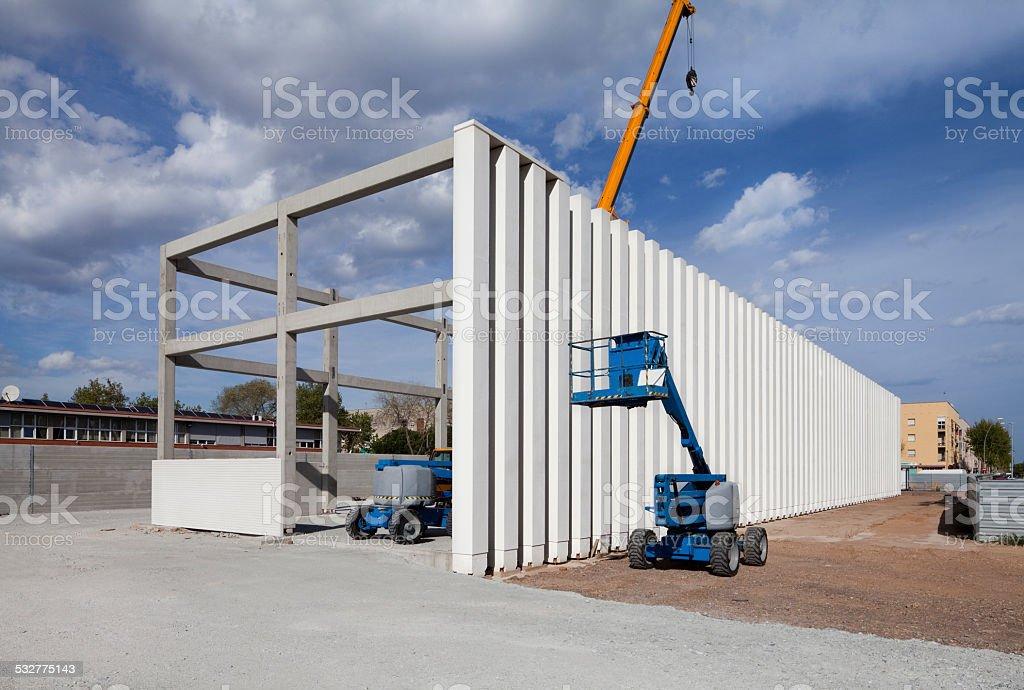Building under construction. Columns. Cranes stock photo