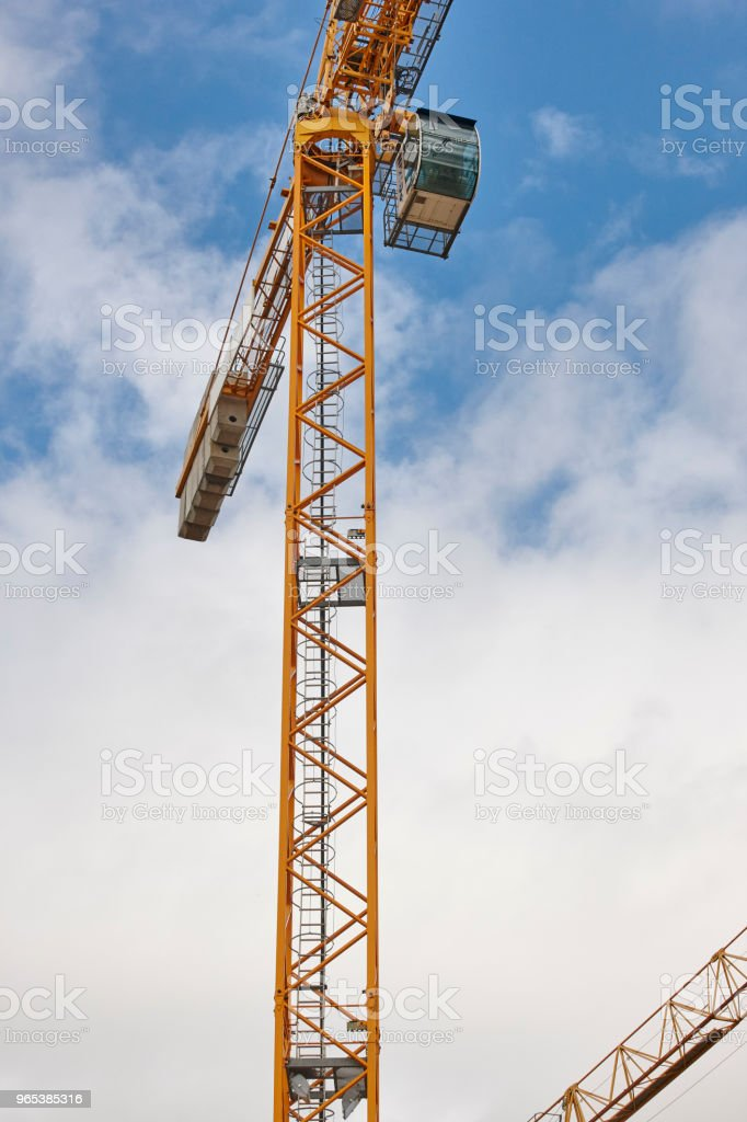 Building under construction. Crane machinery structure. Industry royalty-free stock photo