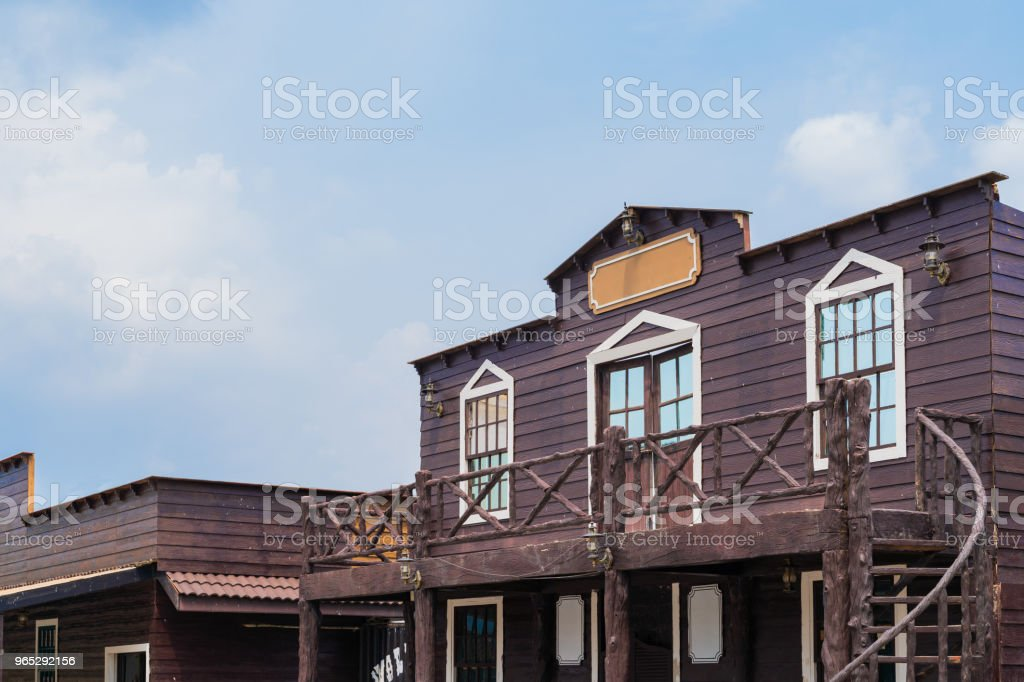 Building ventage cowboy style on blue sky background. royalty-free stock photo