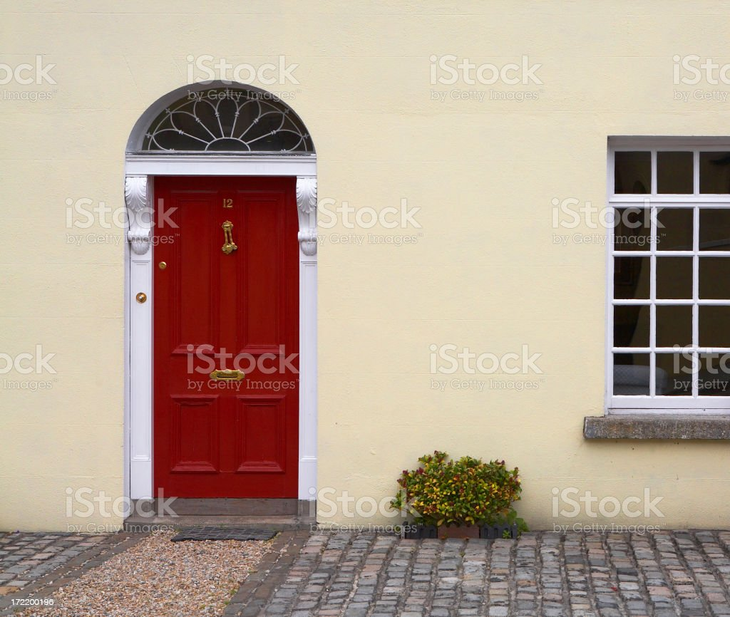 Building view of a red door in apartment stock photo