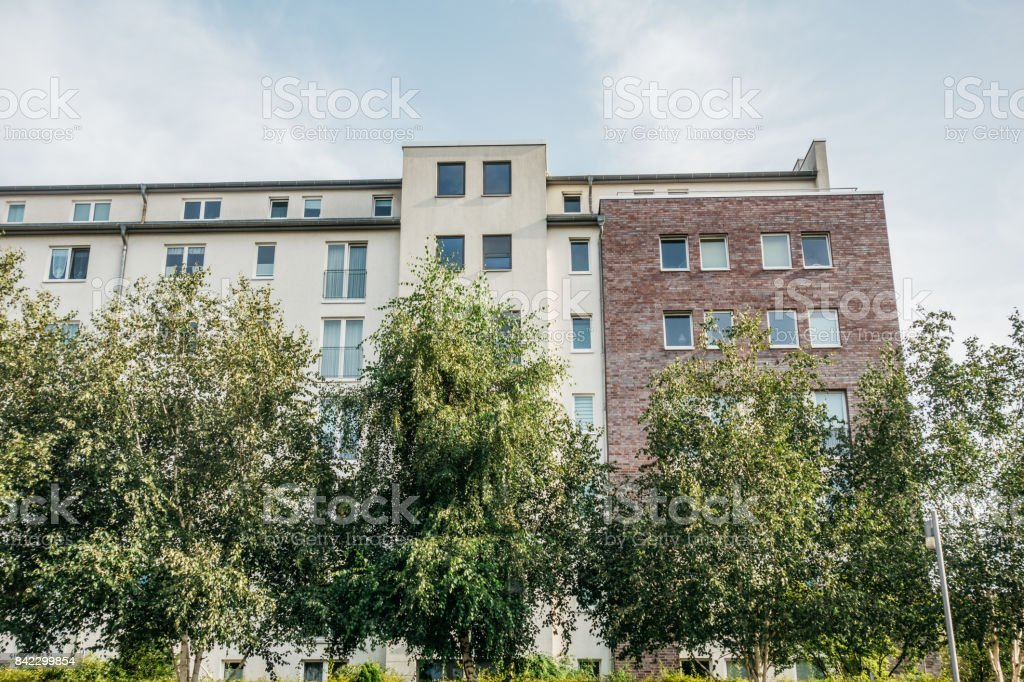 building with big green trees stock photo