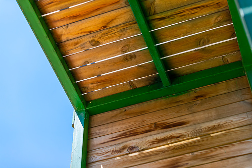 Building with blue sky as a background, terrace wooden railing