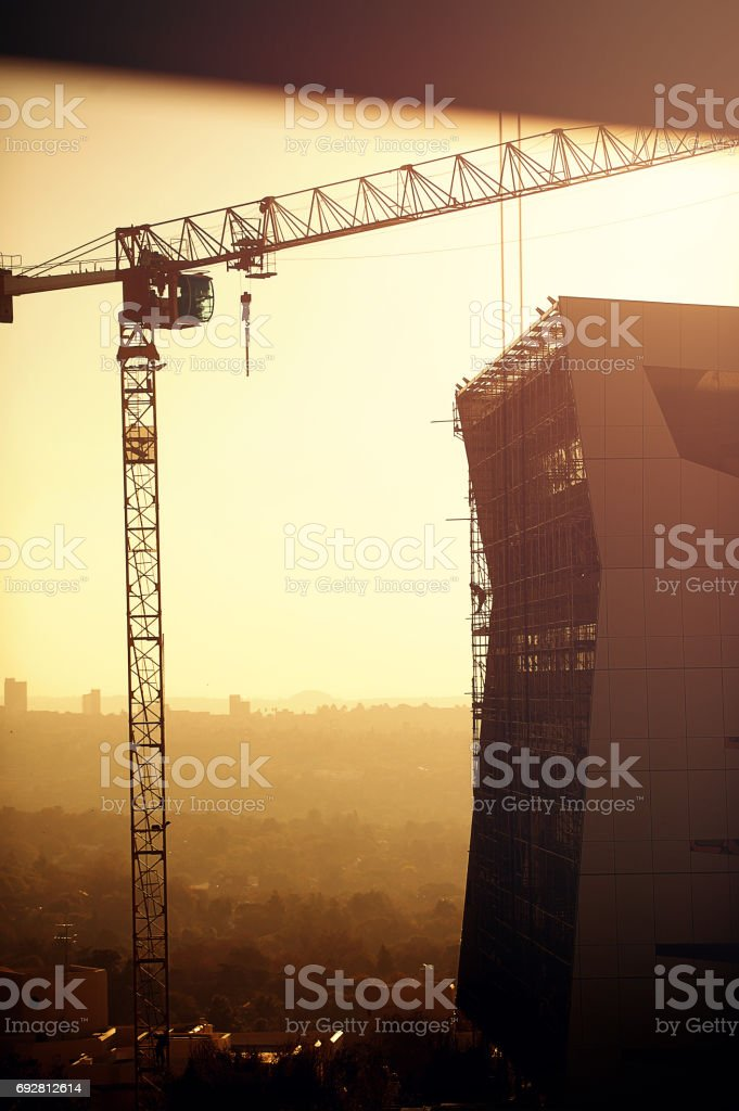 Building with Crane and Person stock photo