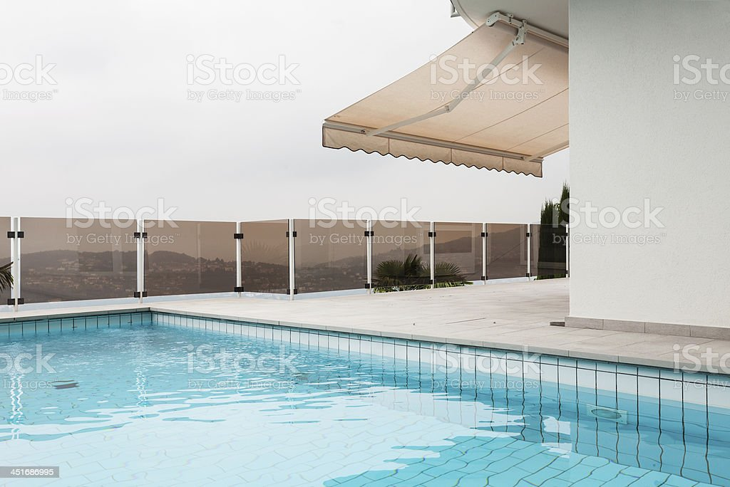 building with pool stock photo