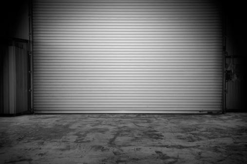 Building with roller shutter door