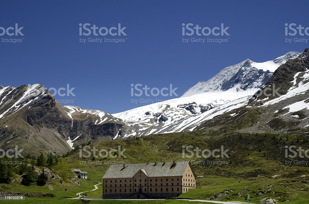 Building with snow-capped mountains stock photo