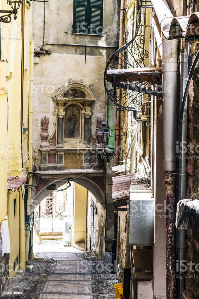 Building with Virgin Mary icon, in old town of Sanremo stock photo