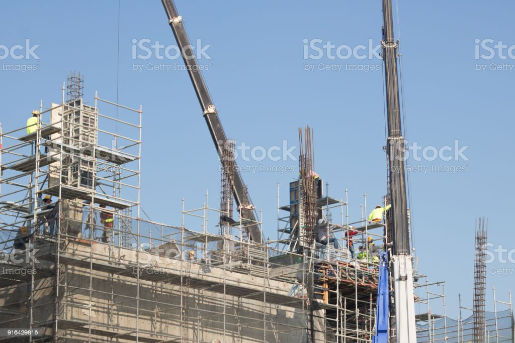 building worker and crane stock photo
