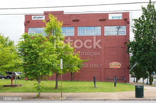 Chattanooga, TN, USA-10 May 2021: A commercial building with signs-logos of tenants: Garrison Logistics, Stryker and Airnet.