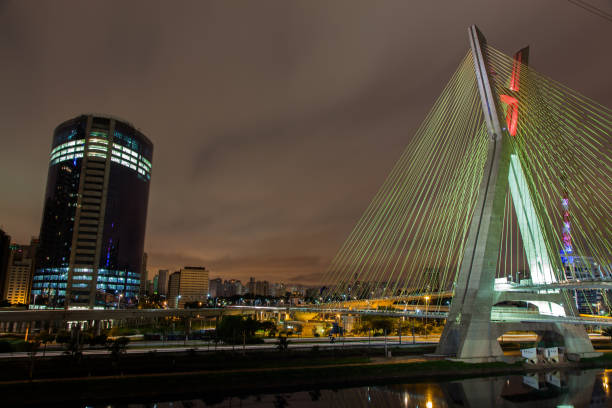 Buildings and cable stayed bridge in Sao Paulo - Brazil - at night stock photo