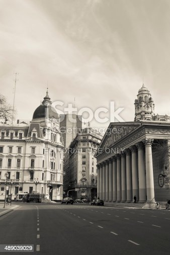 Buenos Aires, Argentina- August 7, 2010: View of the buildings surrounding Plaza de Mayo, with the Buenos Aires Town Hall in the Background and the Metropolitan Cathedral at right, shoot early in the morning, with few people and traffic in the streets.