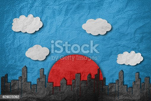 istock Buildings in city with red sun, cloud and blue sky 629023262