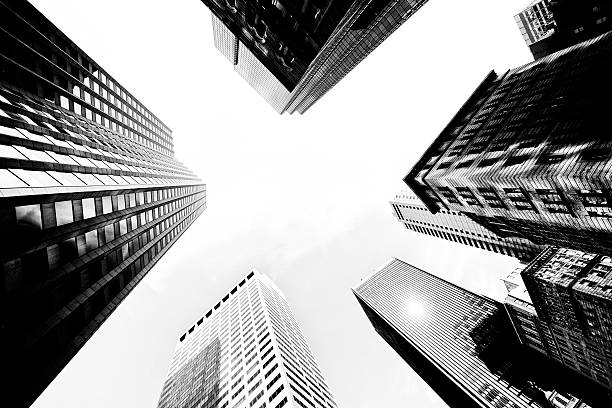 buildings in nyc. - diminishing perspective stock photos and pictures
