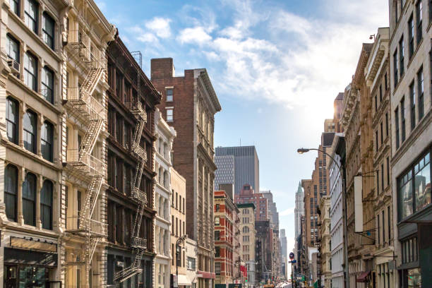 Buildings in SoHo New York City Sunlight shines on the buildings along Broadway in SoHo, New York City NYC soho new york stock pictures, royalty-free photos & images