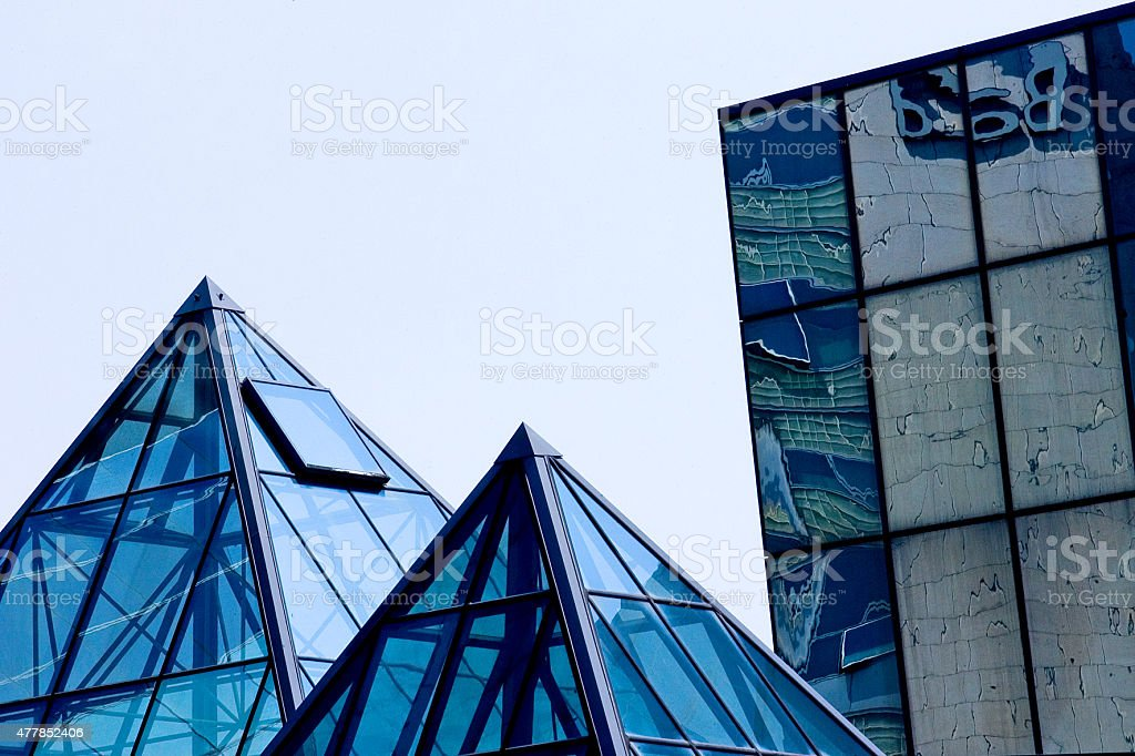 Buildings of glass and steel with pyramid shapes stock photo