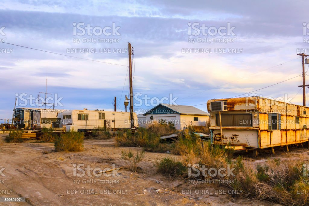 Buildings, old trailers in Bombay Beach, Salton City, California, United States. stock photo