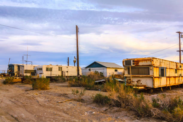 Buildings, old trailers in Bombay Beach, Salton City, California, United States. Bombay Beach, Salton City, California, USA - April 6, 2017: Buildings, old trailers in Bombay Beach, Salton City, California, United States. trailer park stock pictures, royalty-free photos & images