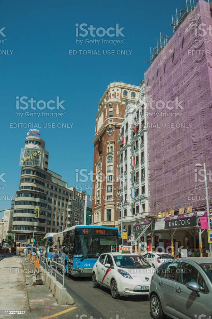 Madrid, Spain - July 25, 2018. Charming old buildings with shops on...