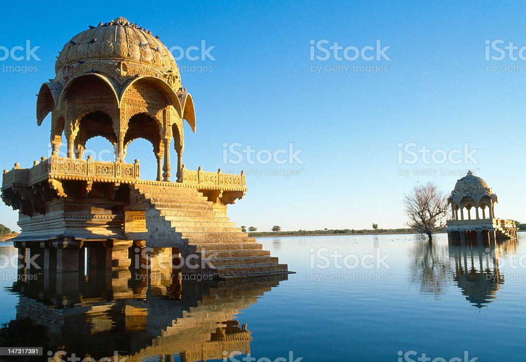 Buildings on Gadi Sagar lake in Jaisalmer, Rajasthan, India stock photo