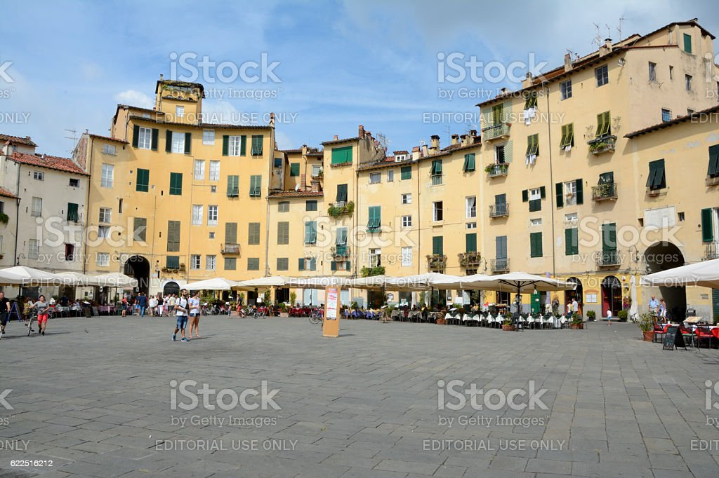 Buildings on Piazza dell'Anfiteatro square in Lucca city in Ital stock photo