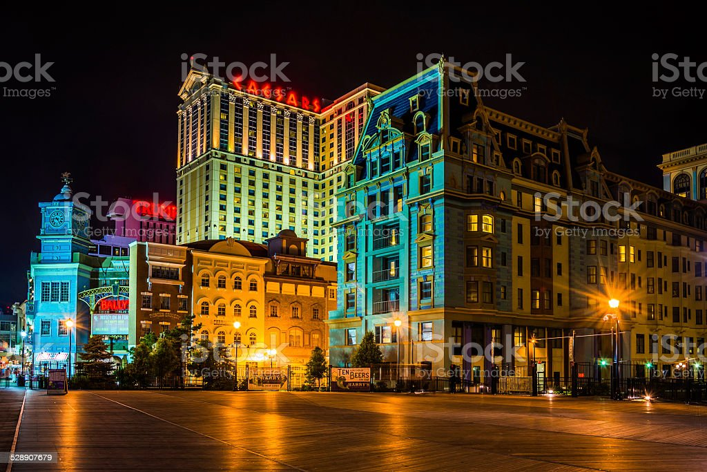 Buildings on the boardwalk at night in Atlantic City stock photo