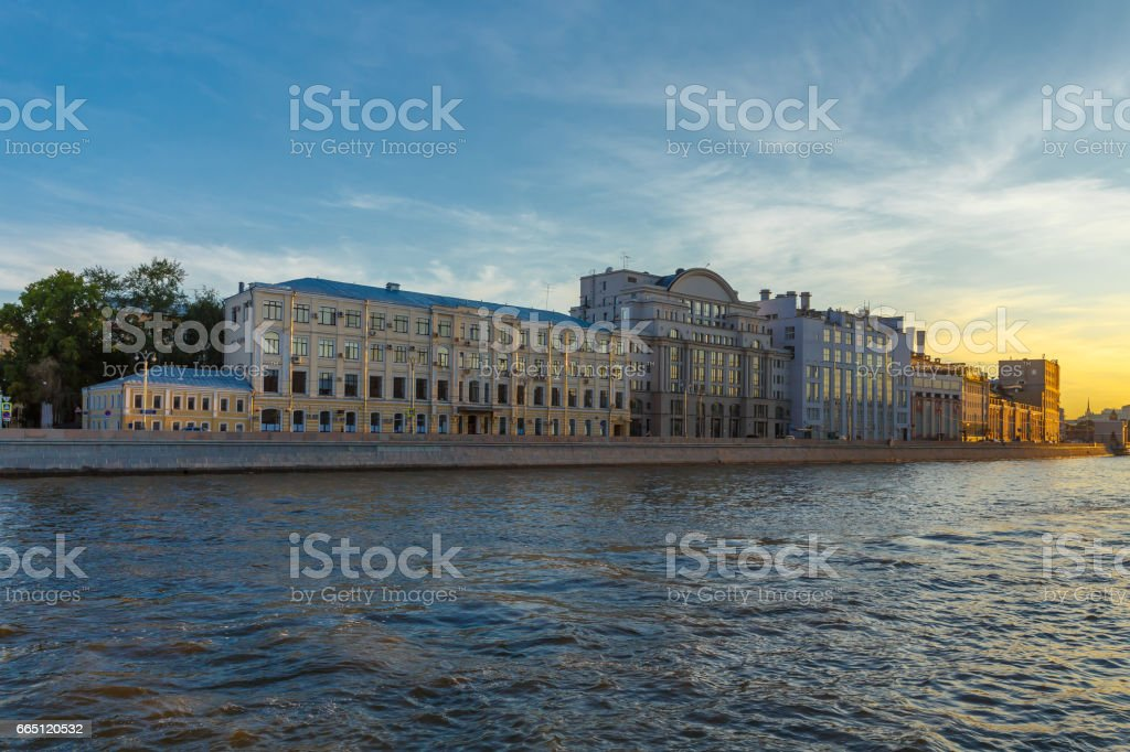 Buildings on the embankment of the Moscow river in the evening. stock photo