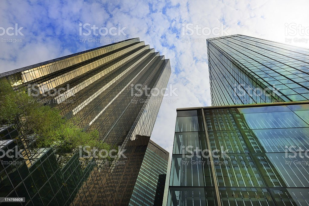 Buildings reaching for the cloudy sky royalty-free stock photo