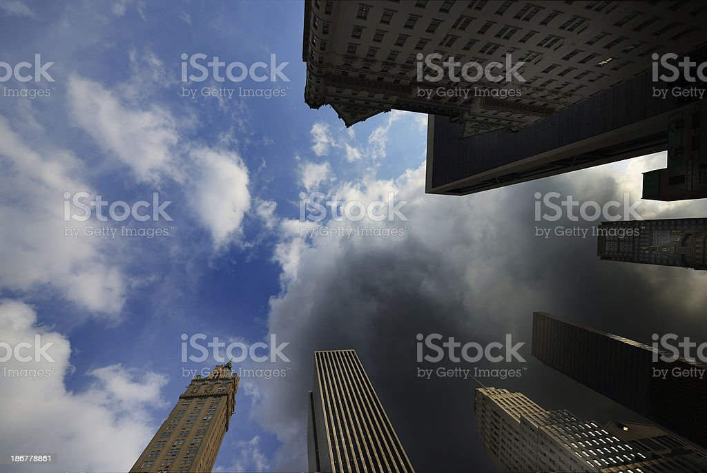 NYC buildings reaching for the cloudy sky royalty-free stock photo