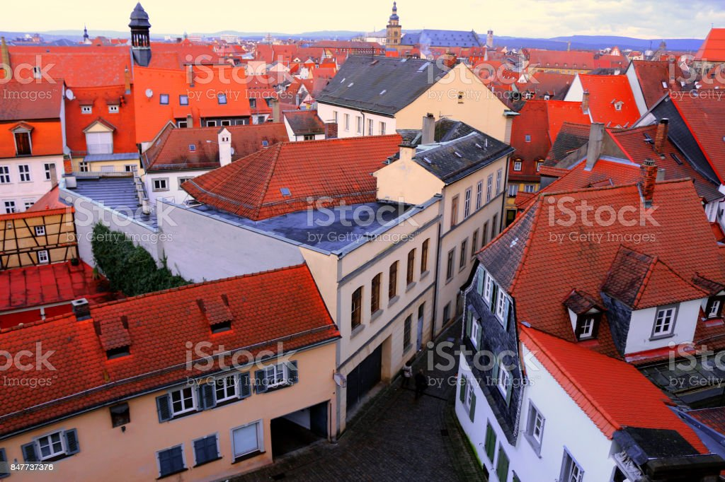 Buildings red rooftops European houses cityscapes accommodation streets tiles town stock photo
