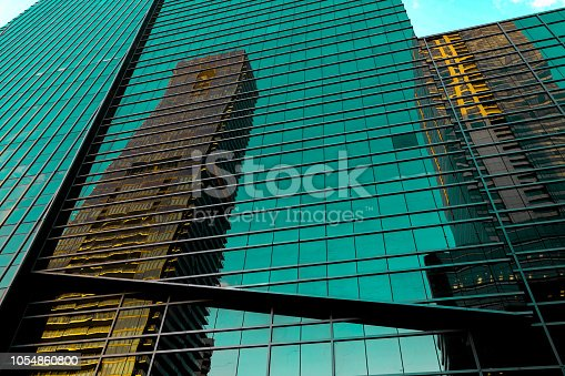 istock Buildings reflected in windows of modern office building 1054860800